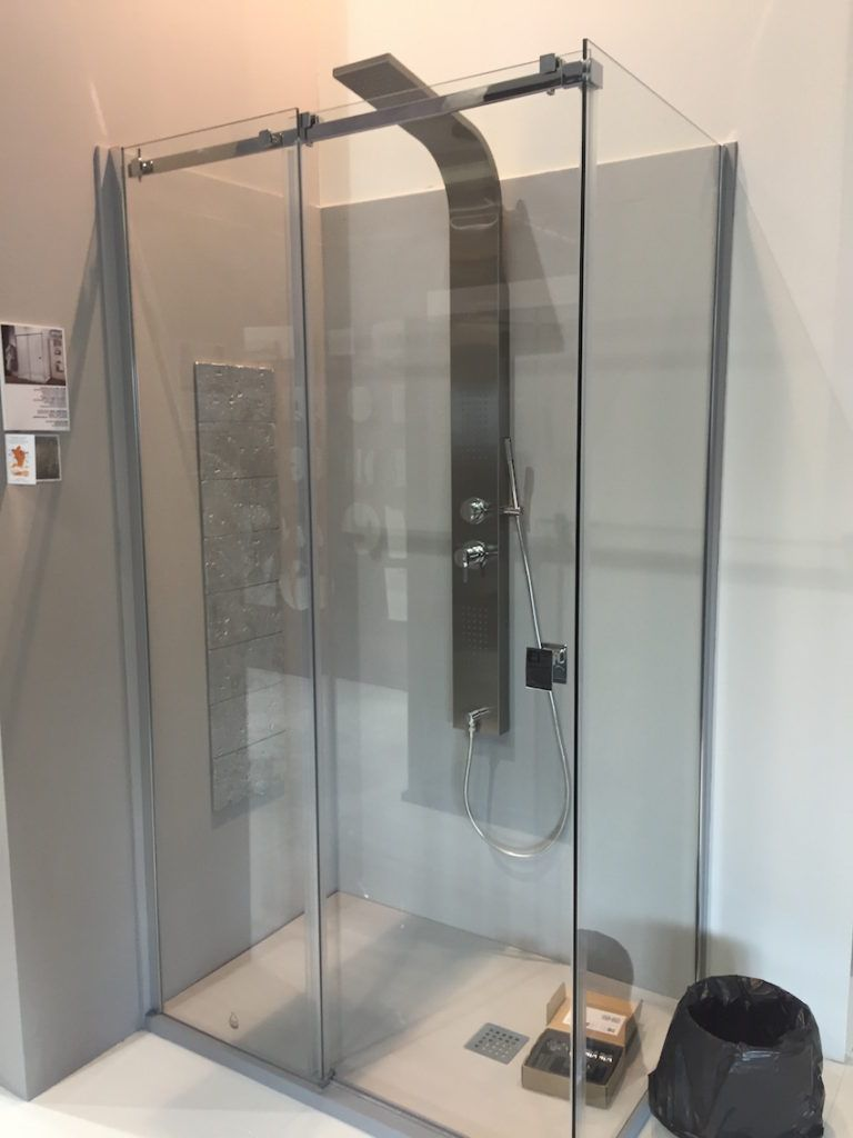 A regular shower an be updated with a new rainfall shower component.