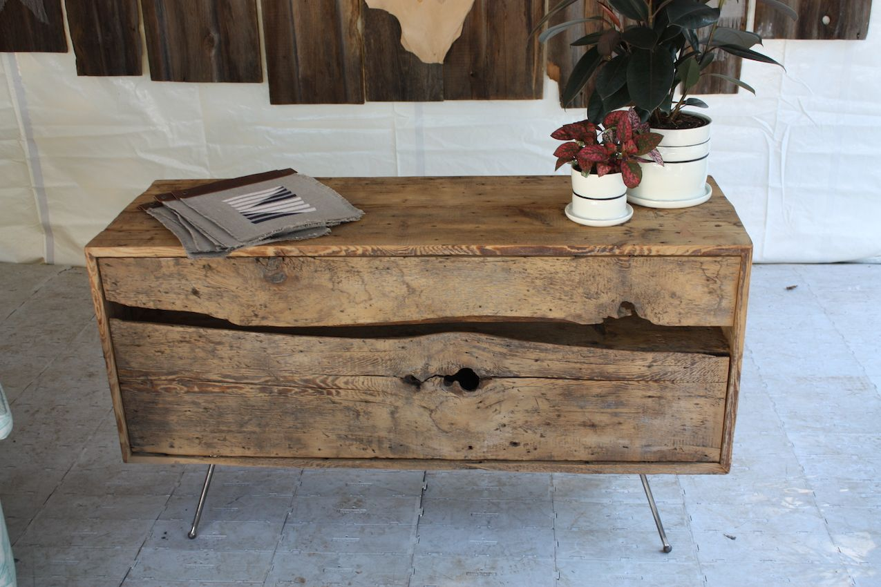 The credenza is very rustic yet modern thanks to the spare legs and slim design.