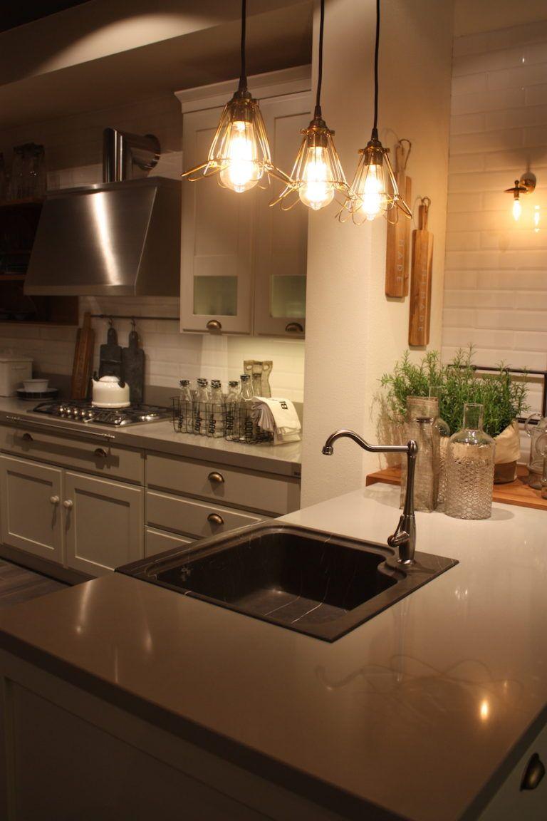 Scavolini's single compartment sink has a unique corner-mounted faucet.