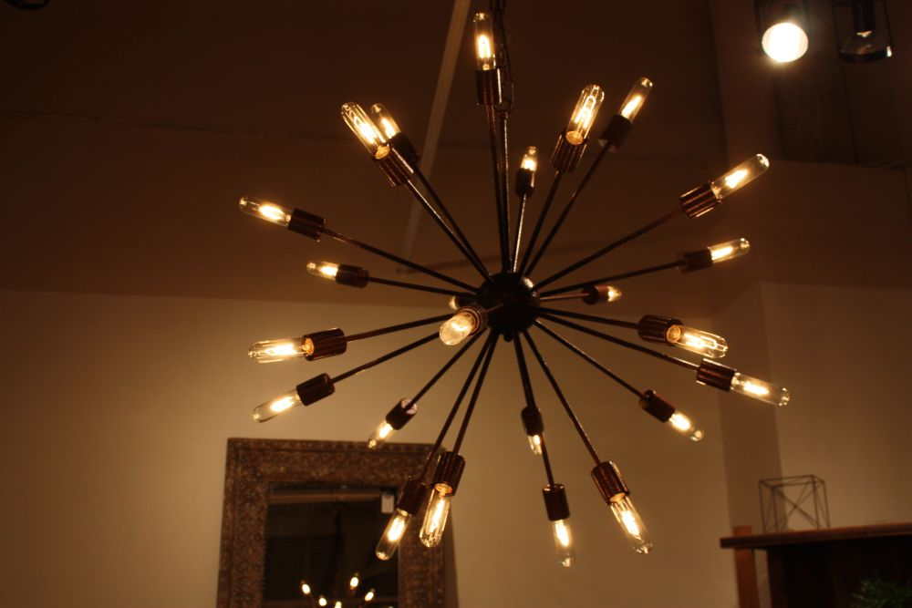 Add a bit of drama to your life with a black chandelier starburst black chandelier aloadofball Images