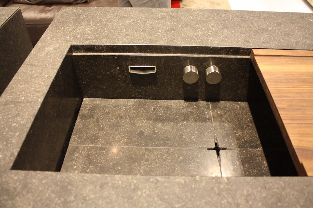 Stenninger has a sleek version where the knobs and tap are below the counter surface, and includes a sliding wood panel.