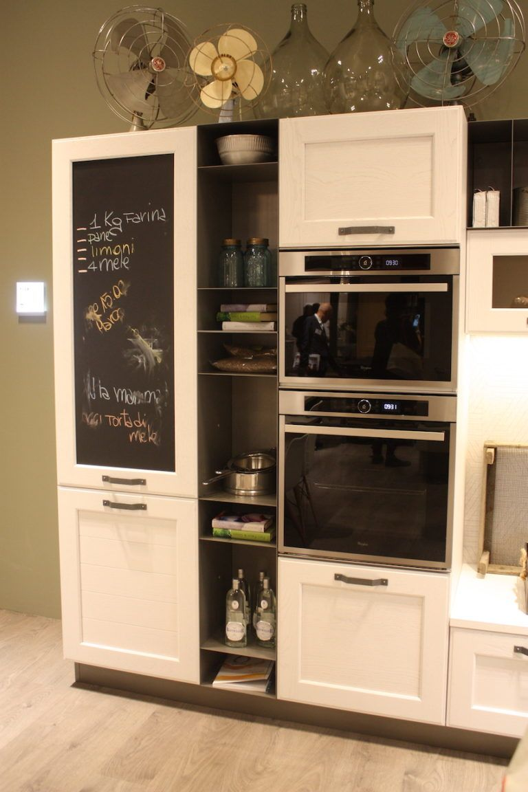 A more casual style in this Stosa kitchen includes cupboards, appliances, open shelving and a chalkboard.