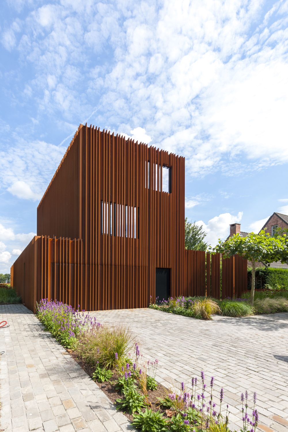 The Corten House by DMOA Architecten