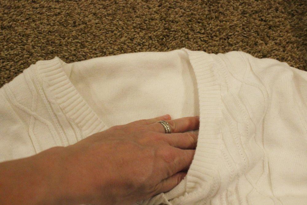 Tuck the flattened sleeve