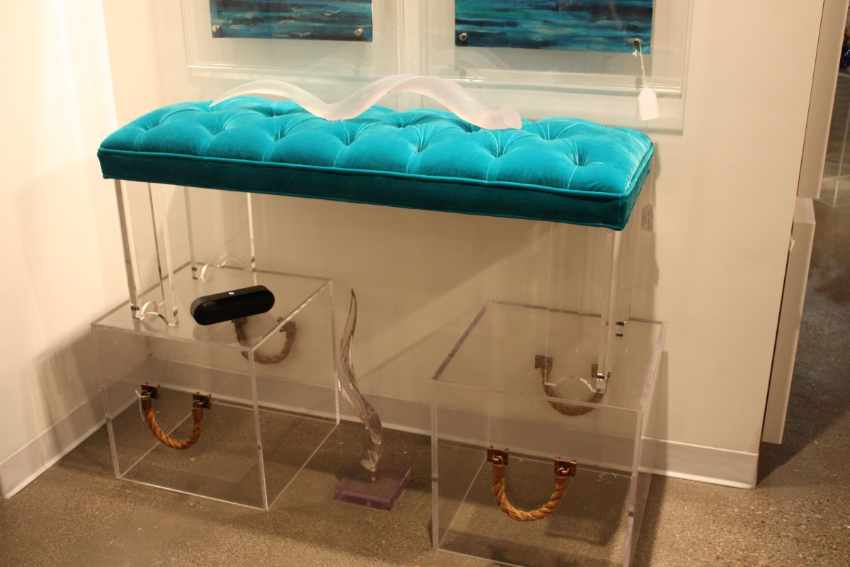 Tufted turquoise bench with acylic base and boxes
