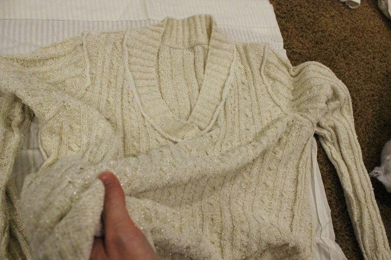 Turn the sweater inside-out