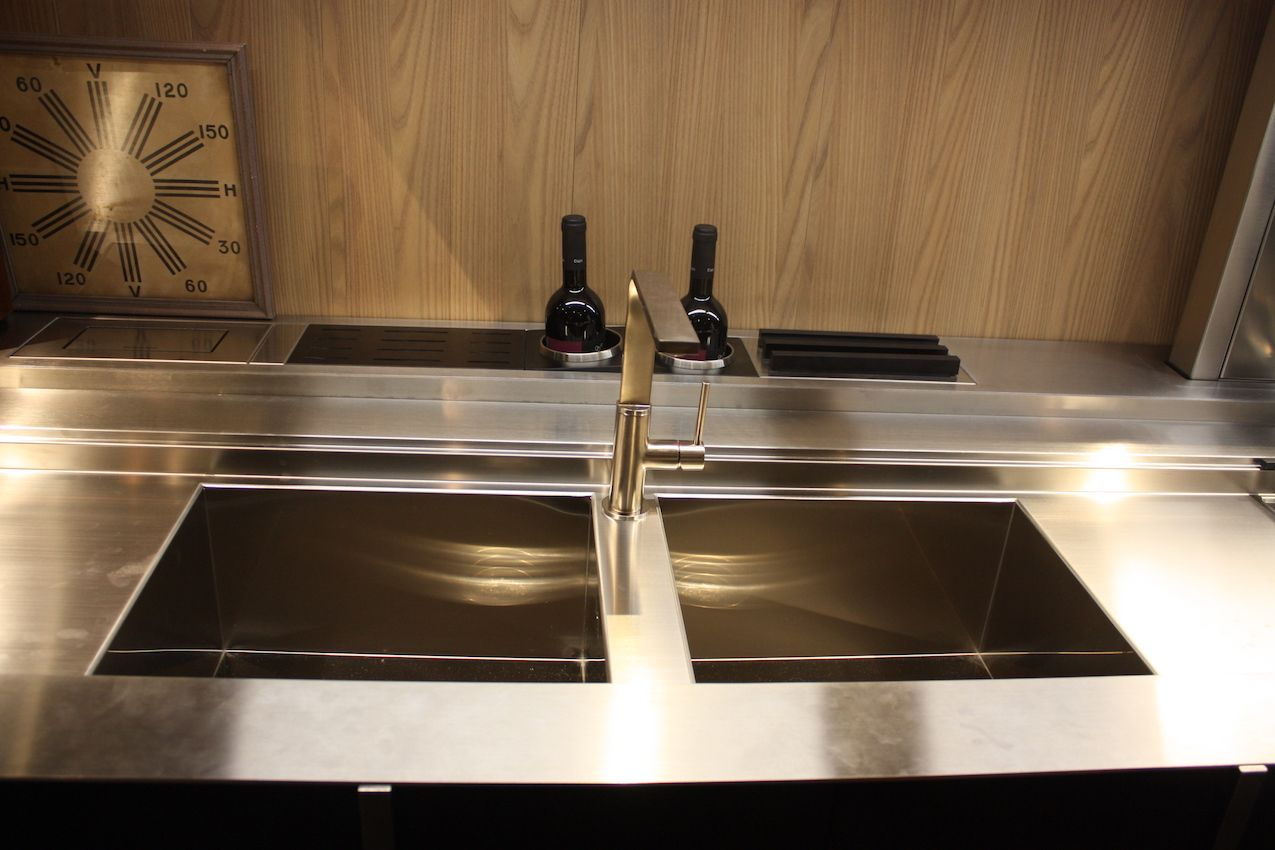 A double sink can have a faucet installed in the center divider. This one is by Valdesign.
