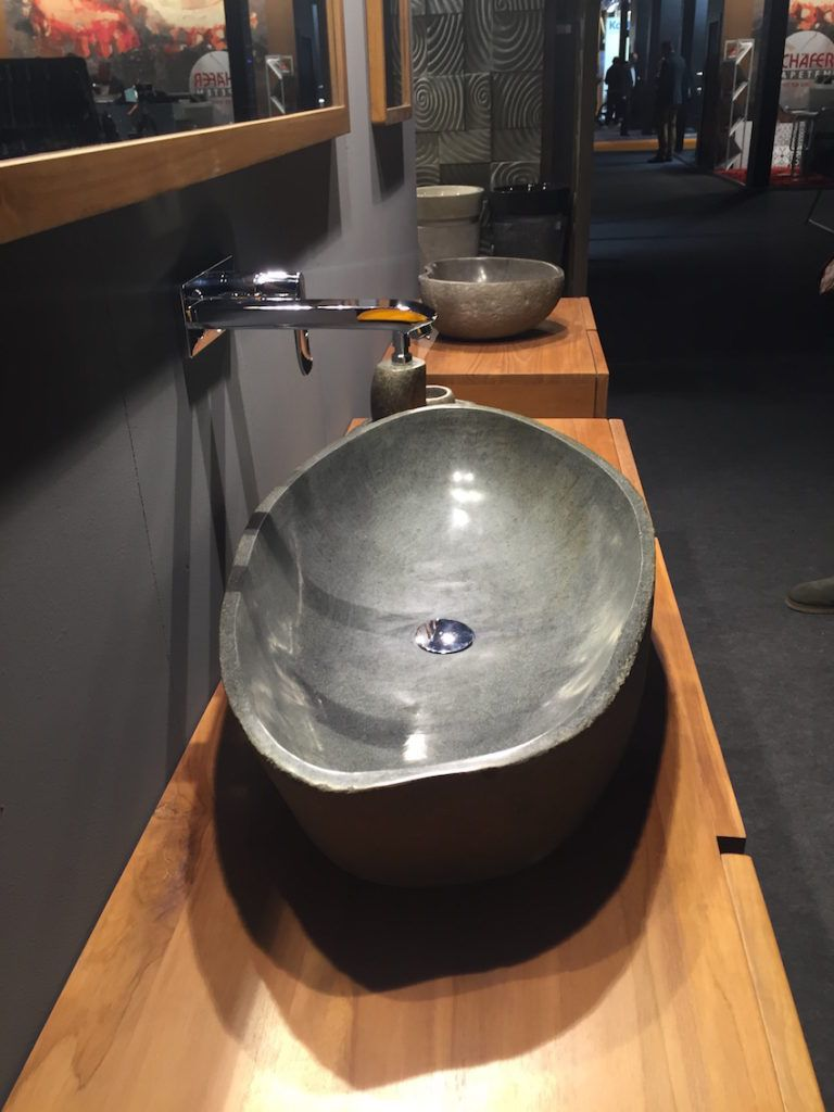 Vessel shaped stone sinks give a particularly natural feel