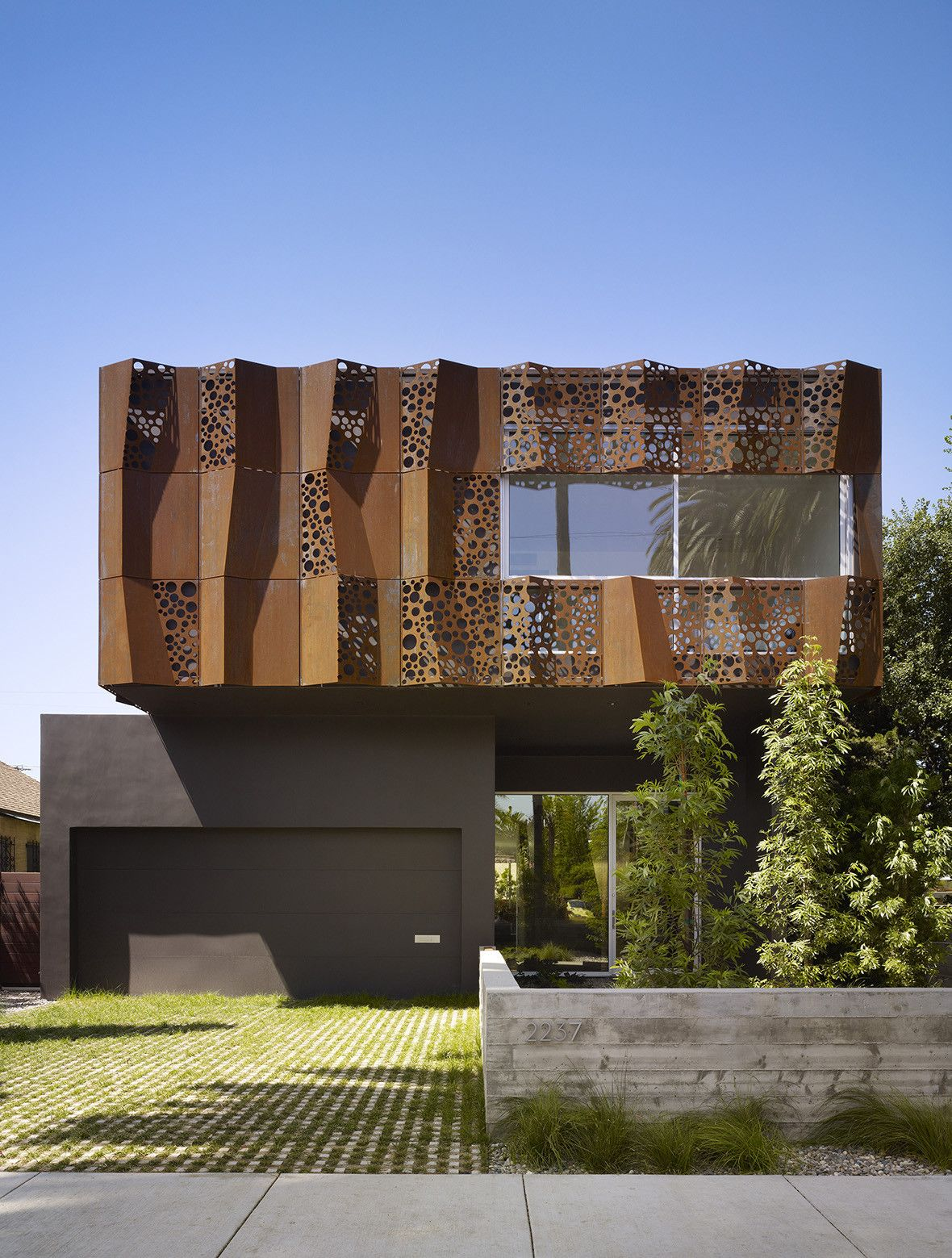 gorgeous corten facades that gracefully withstand the test of time. Black Bedroom Furniture Sets. Home Design Ideas