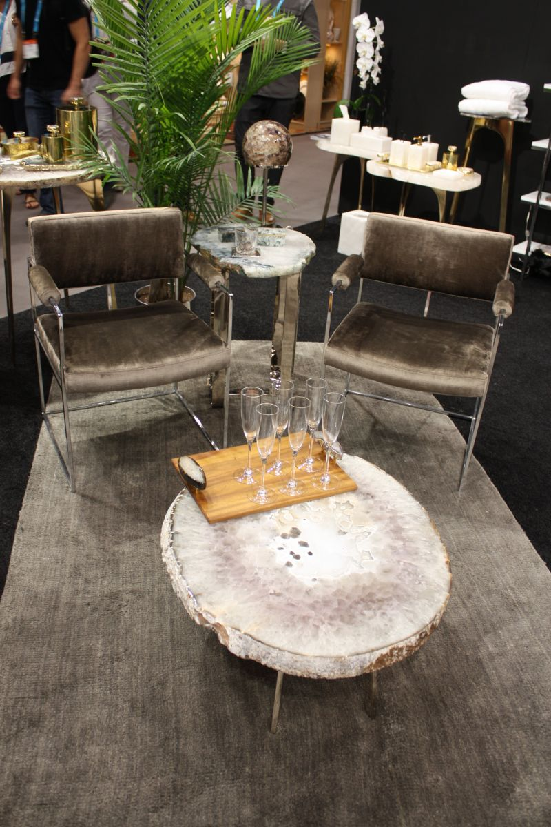 Wire chrome chairs with a round gemstone coffee table