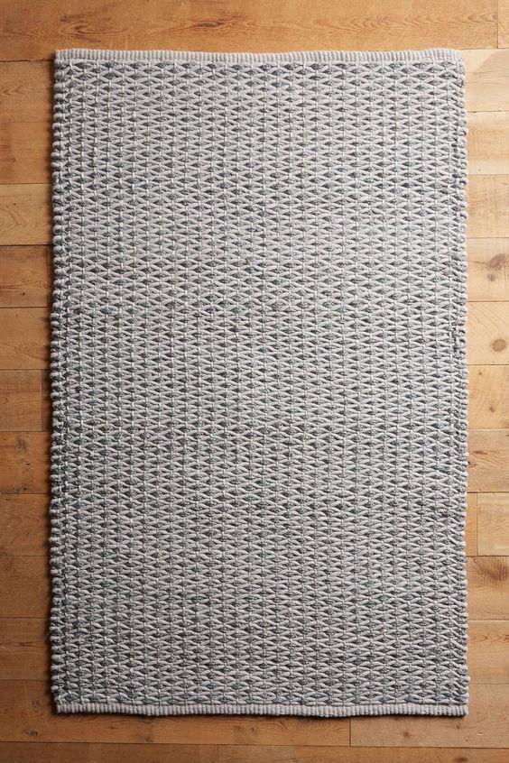 Woven dark floor rug