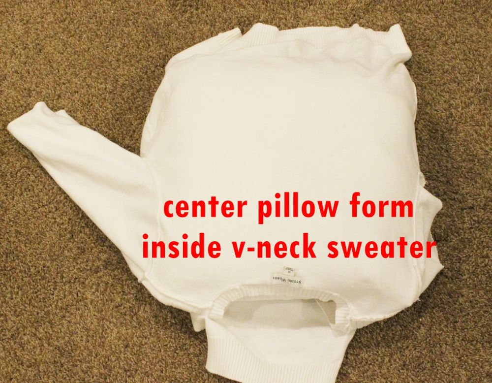 sweater inside-out and slide the pillow