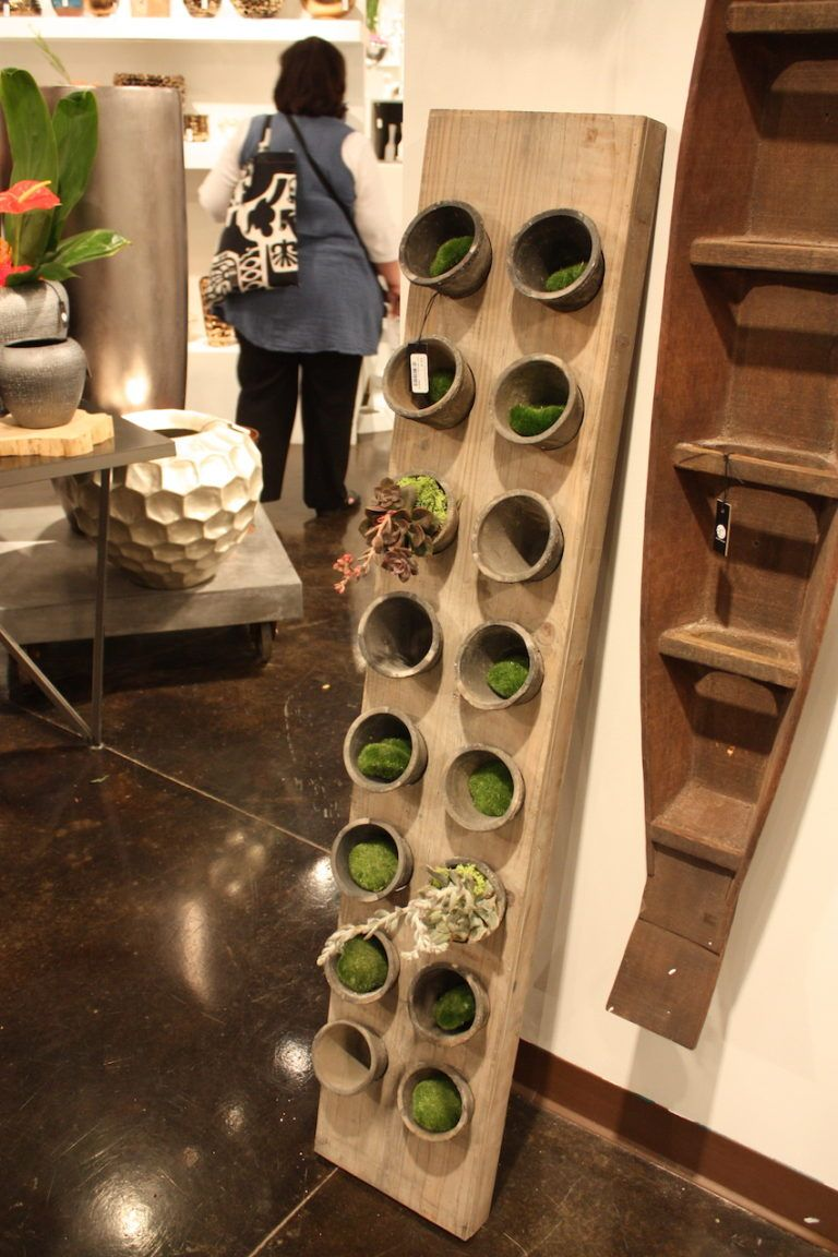 A vertical panel of rustic pots by Accent Decor is perfect for the kitchen or family room.