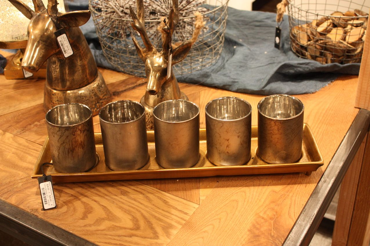 Accent Decor has a set of votive holders on a tray.