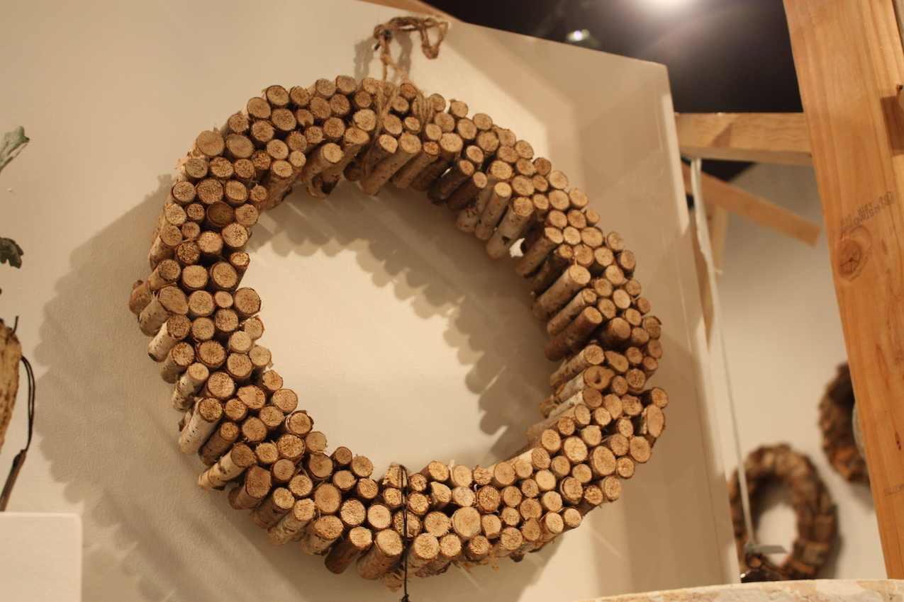 Hung by a twine bow, this wreath from Accent Decor adds a touch of rustic wood.
