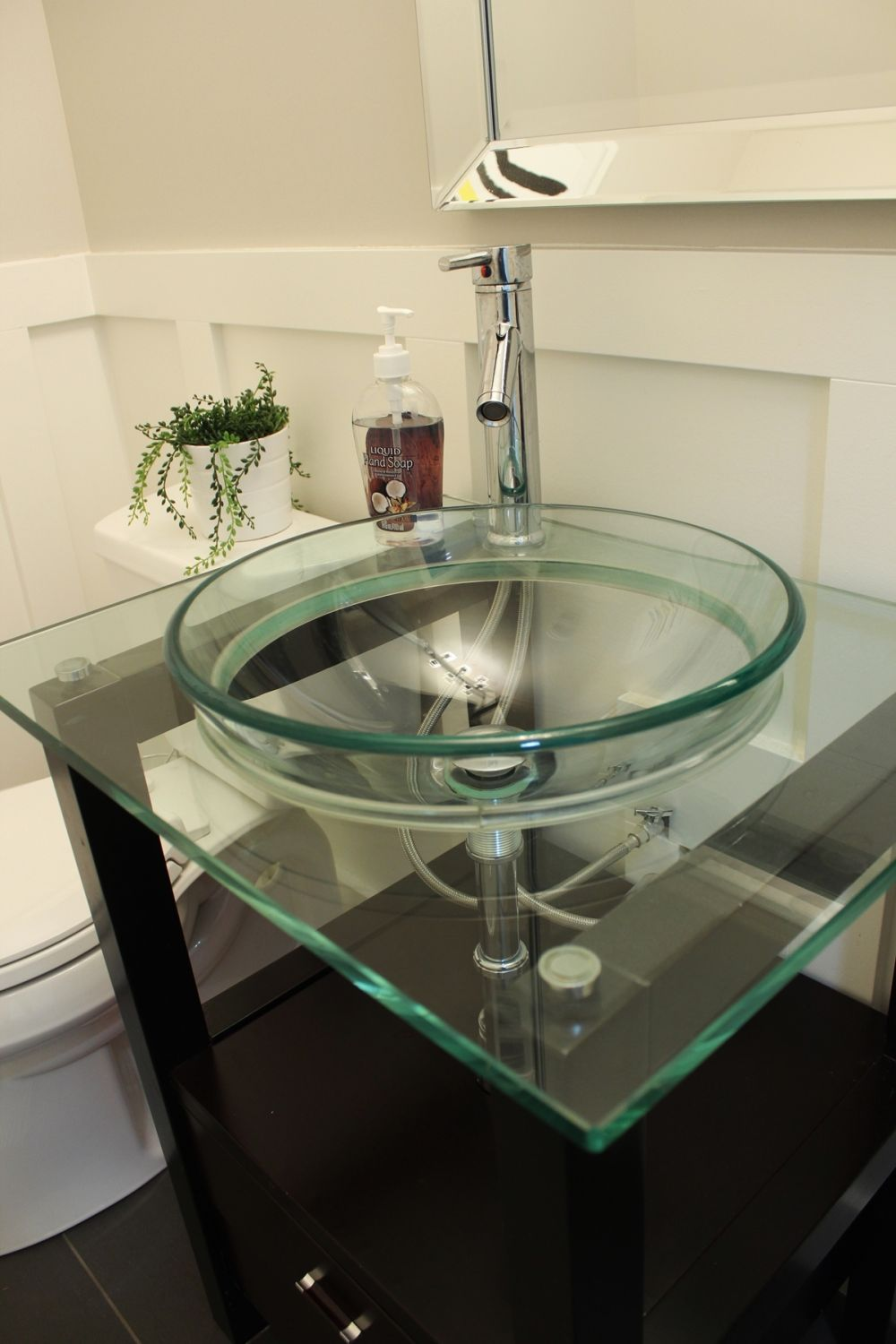 Bathroom with glass bowl sink.