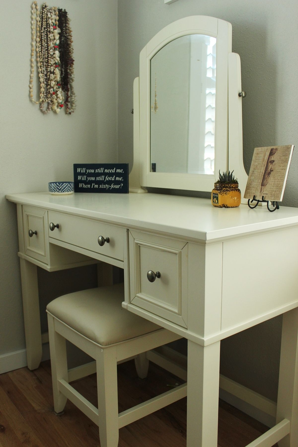 Bedroom with white vanity