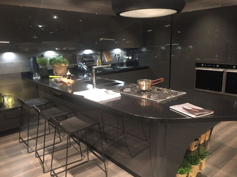 Black kitchen with bar height table