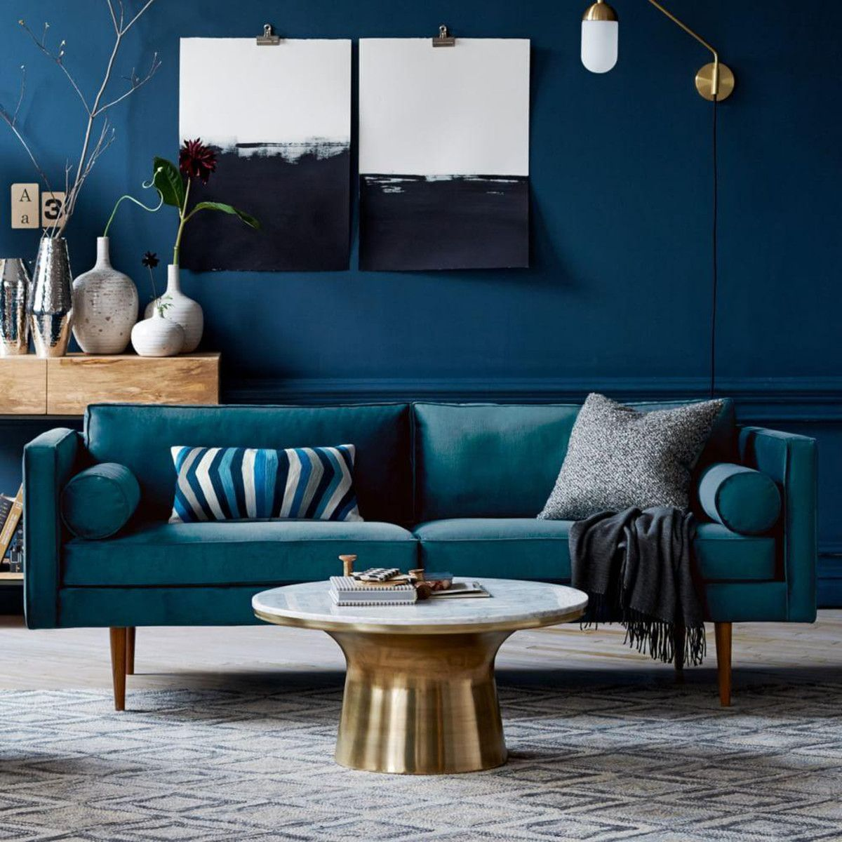 Blue mid-century sofa with coffee table