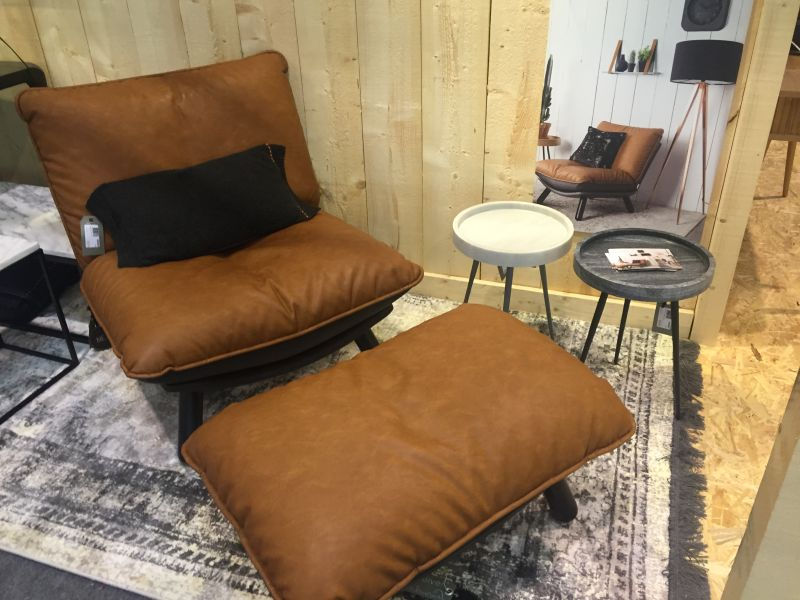 Comfort and style with leather amrchair plus ottoman