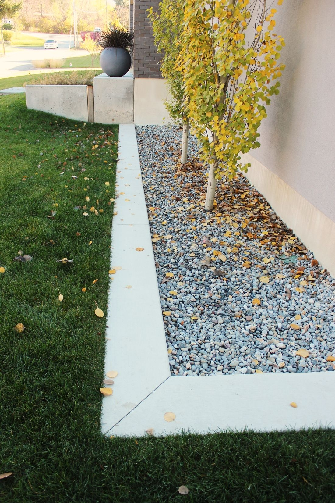 Curb Appeal - landscaping is clean-lined and custom