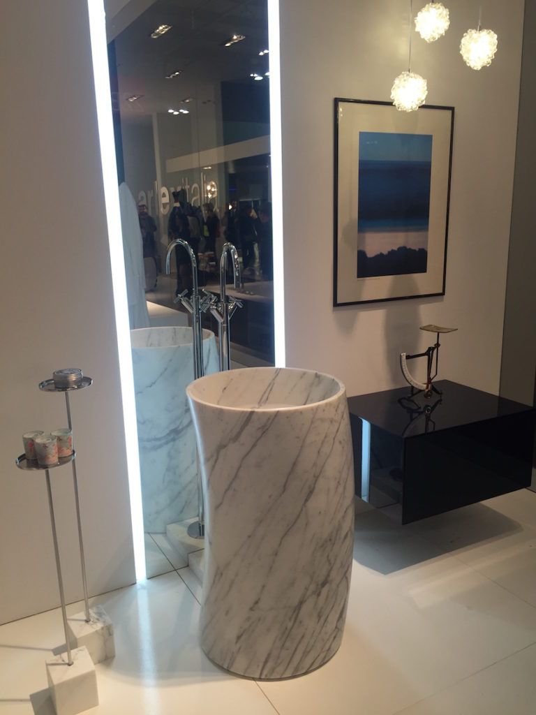 A gently curved cylindrical pedestal of marble is modern and unexpected.