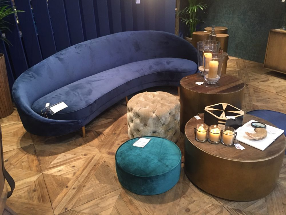 Awesome Curved Velvet Sofa With A Selection Of Round Ottomans Gallery