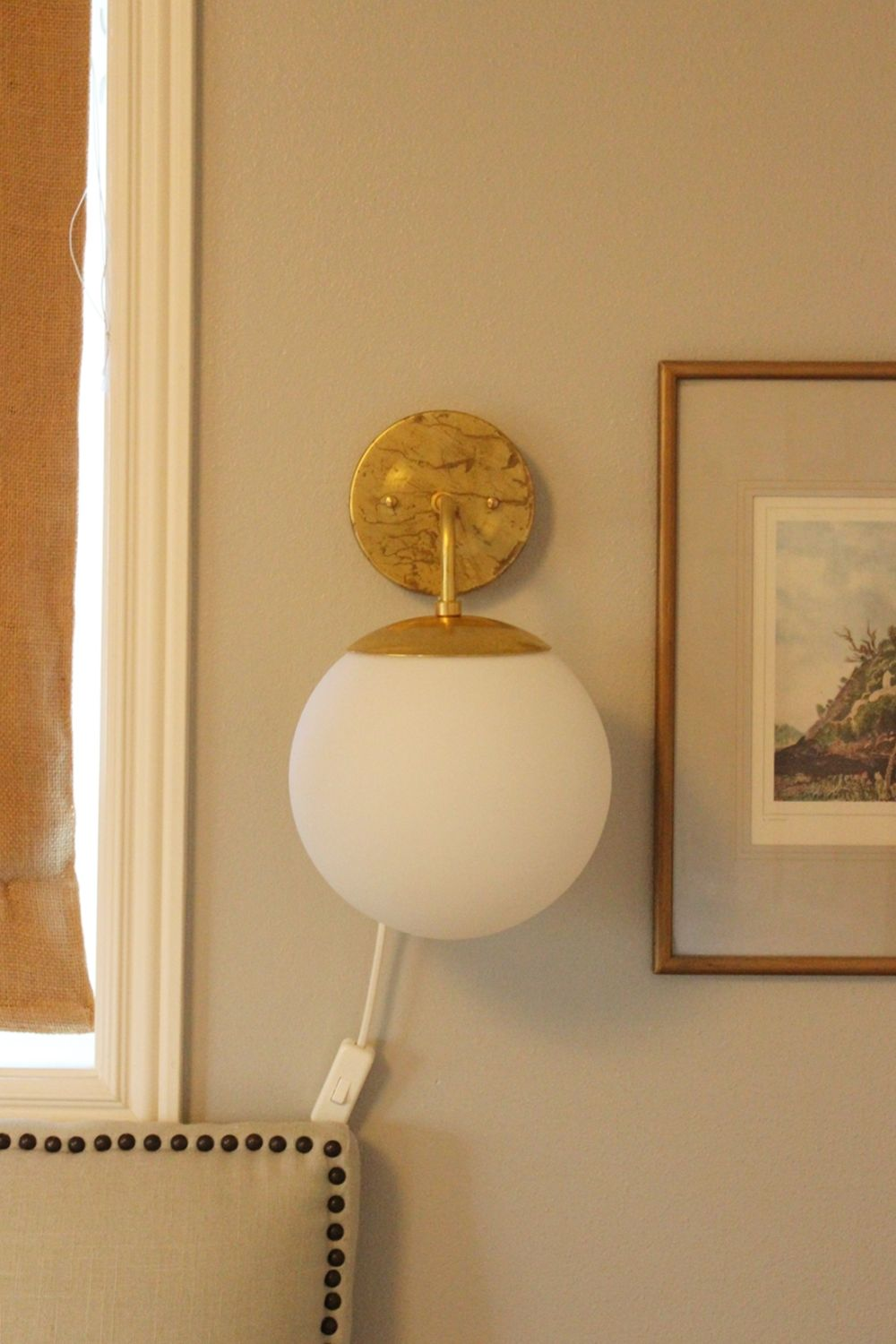 DIY Globe Wall Sconce Above Sofa