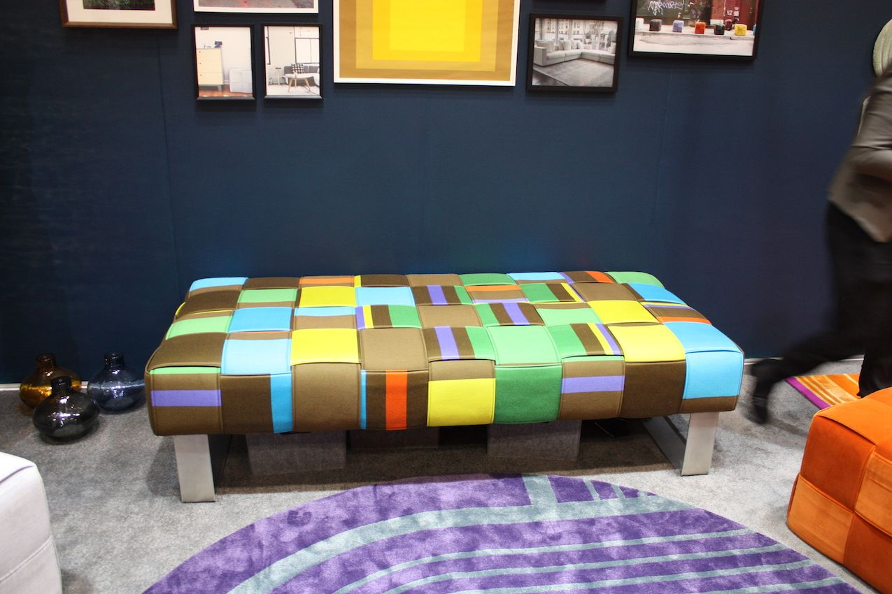 Tutu uses vibrant colors in her benches, stools and rugs.