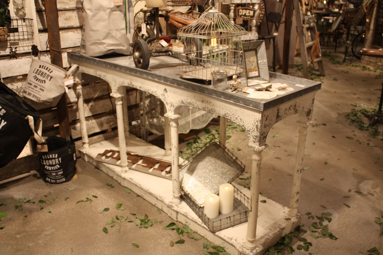 Peacock Park plays up the distressed look of this console with plenty of rustic accessories.