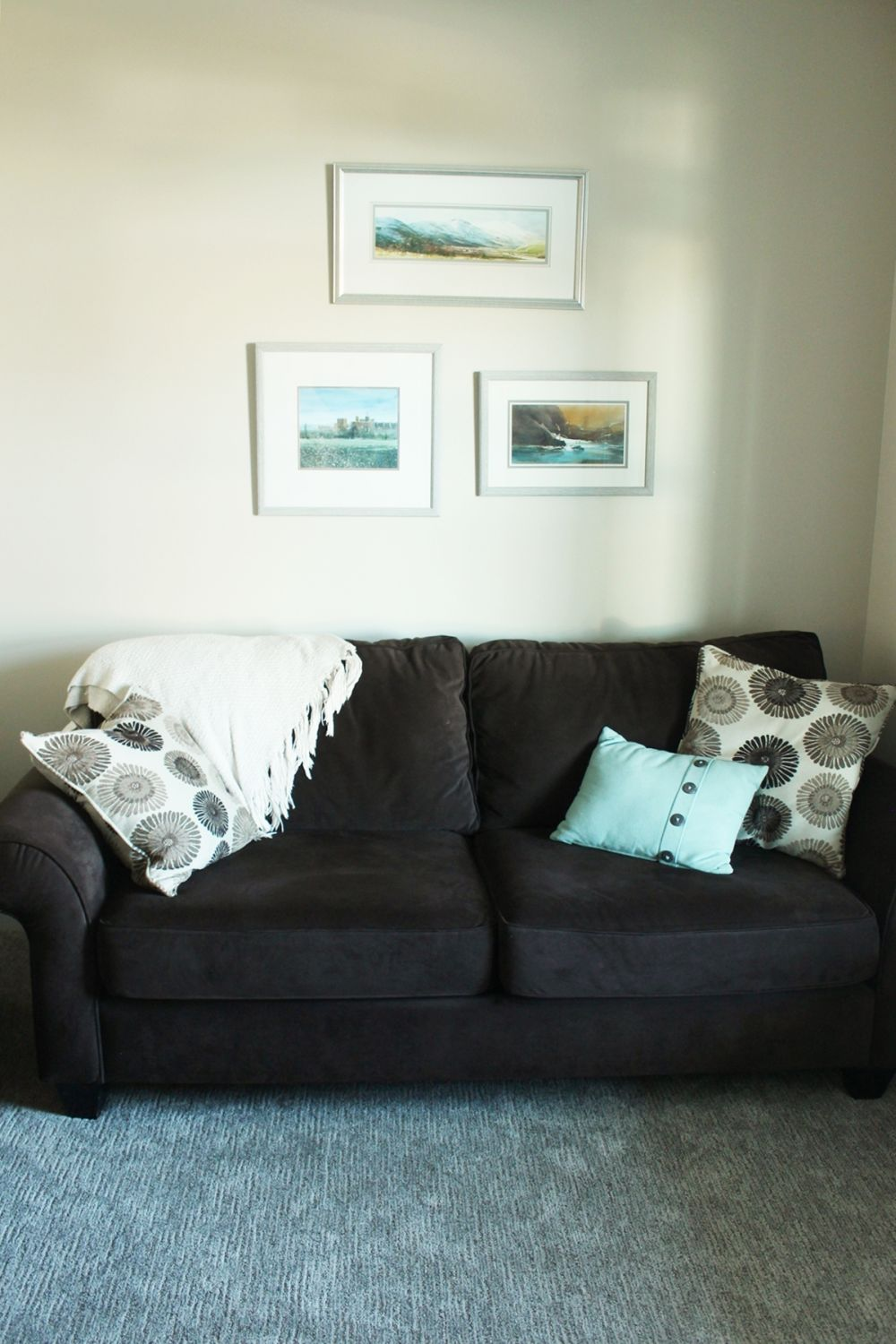 Framed pictures above the sofa