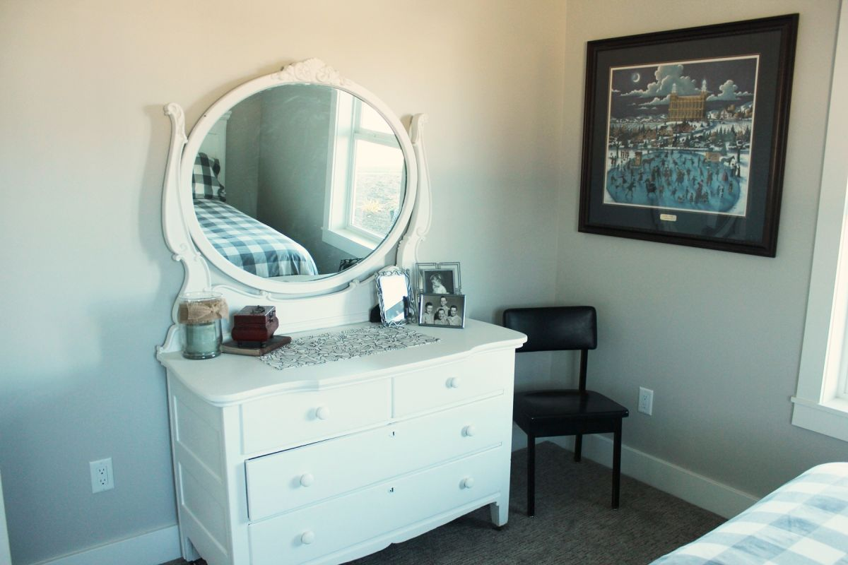 Guest Bedroom with scalloped-edge mirror vanity