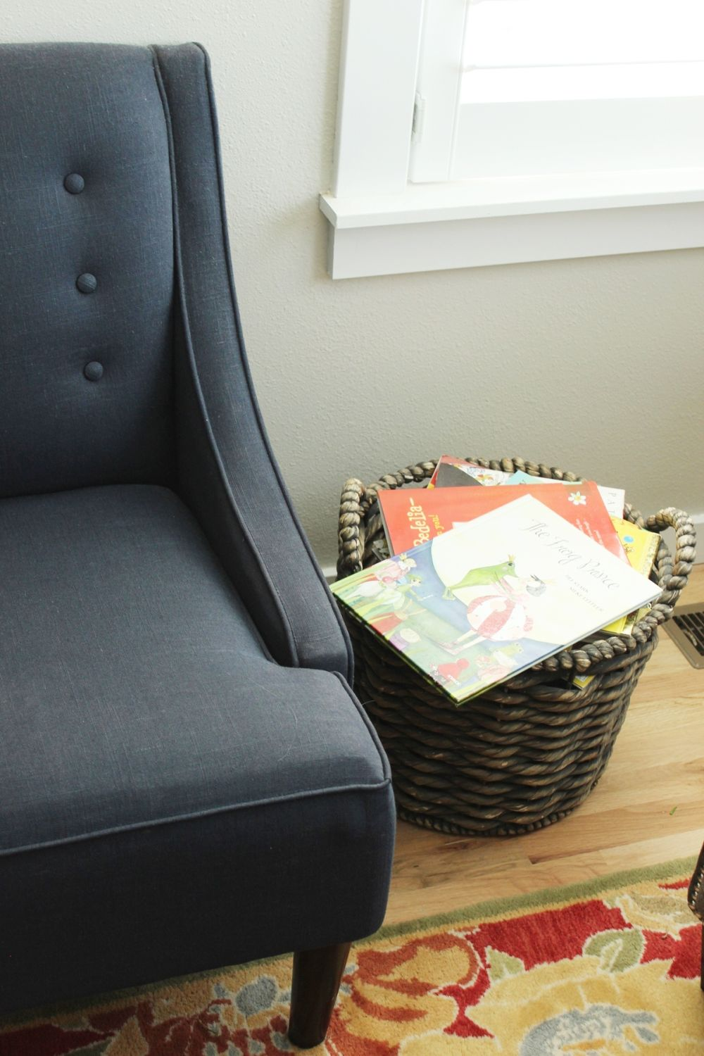 How to Decorate Living Room - tufted chair and rattan storage basket
