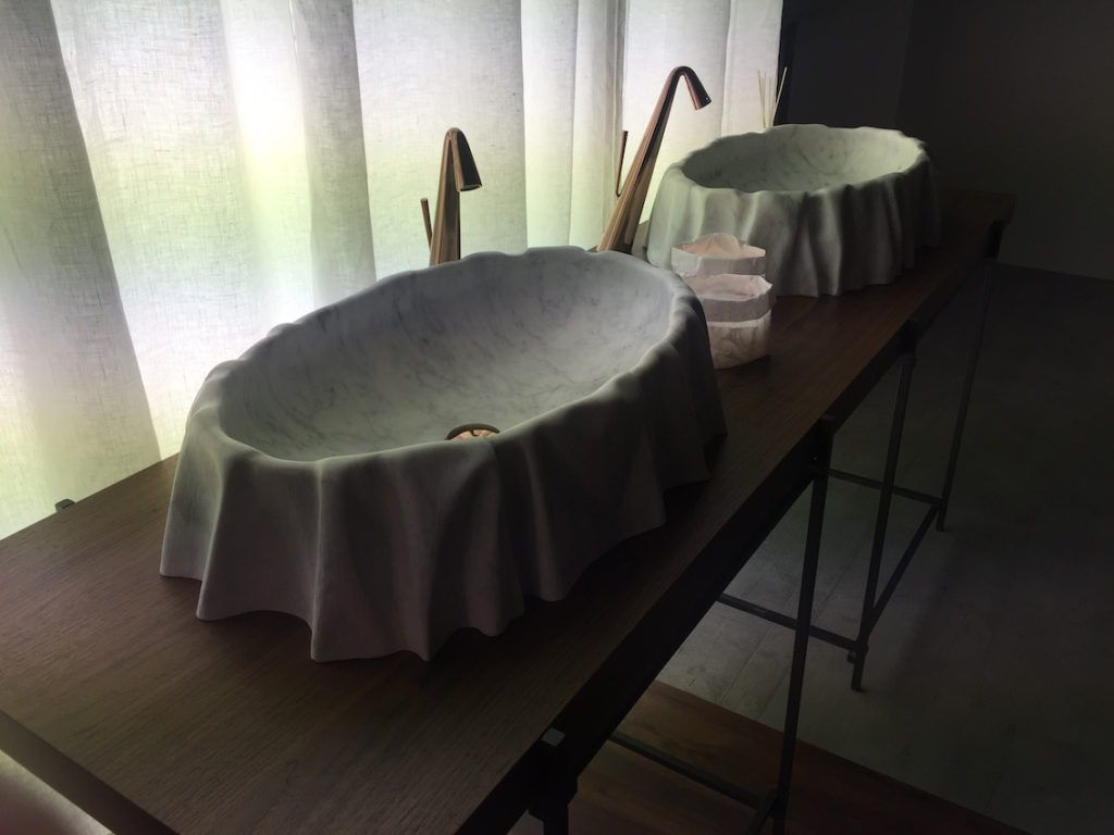These stone sinks look as if the vesselis draped with stone.