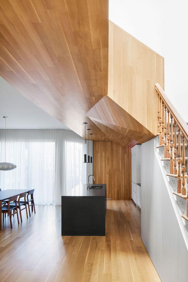 La Casa renovation in Montreal wooden ceiling geometry