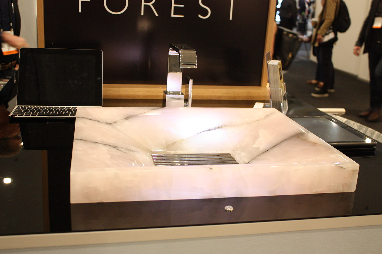 A square marble vessel set low into the counter is also a stunning option.