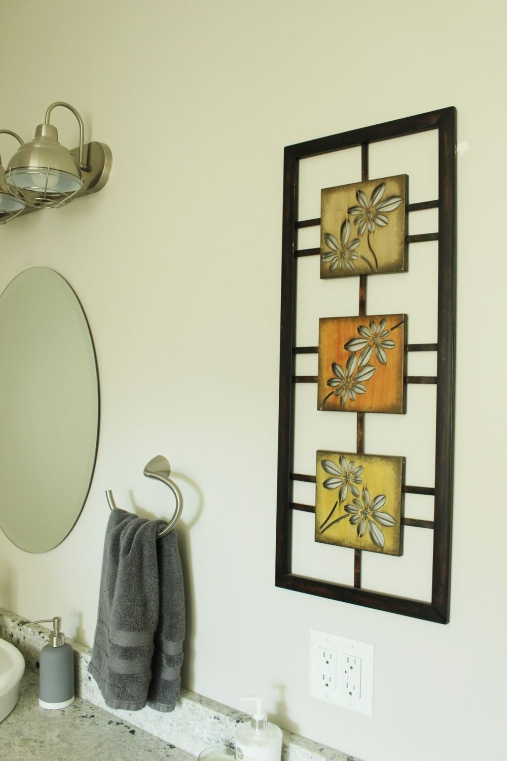 Master bathroom with metal wall art
