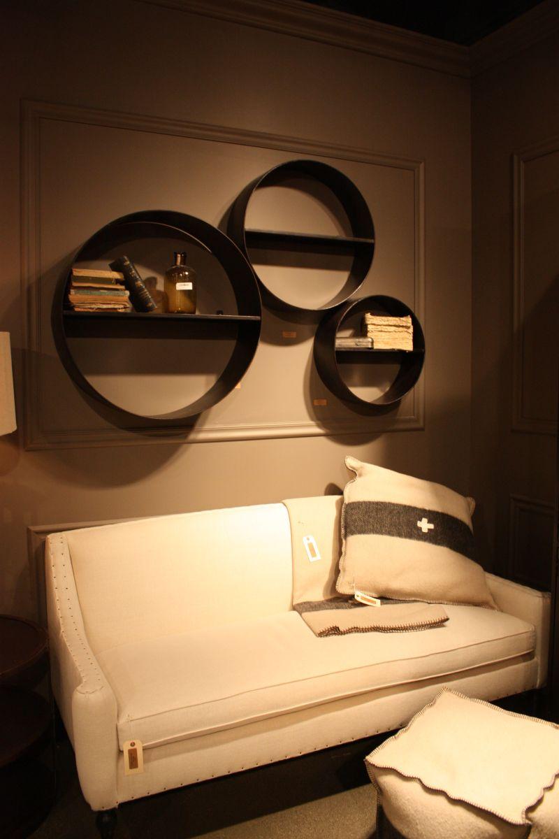 Metallic shelves above the sofa