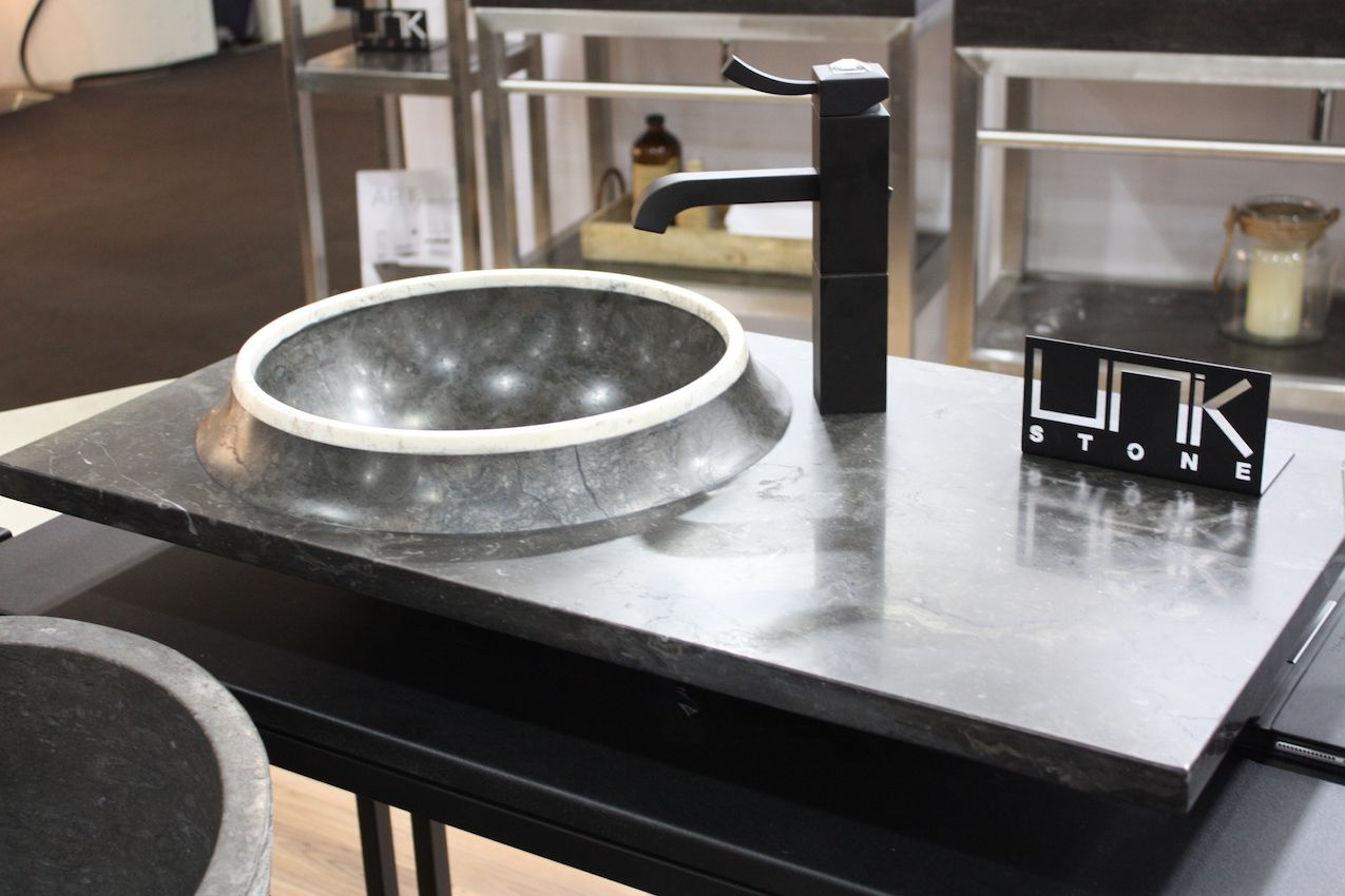 An off-center sink in a gray stone counter from UNIK.