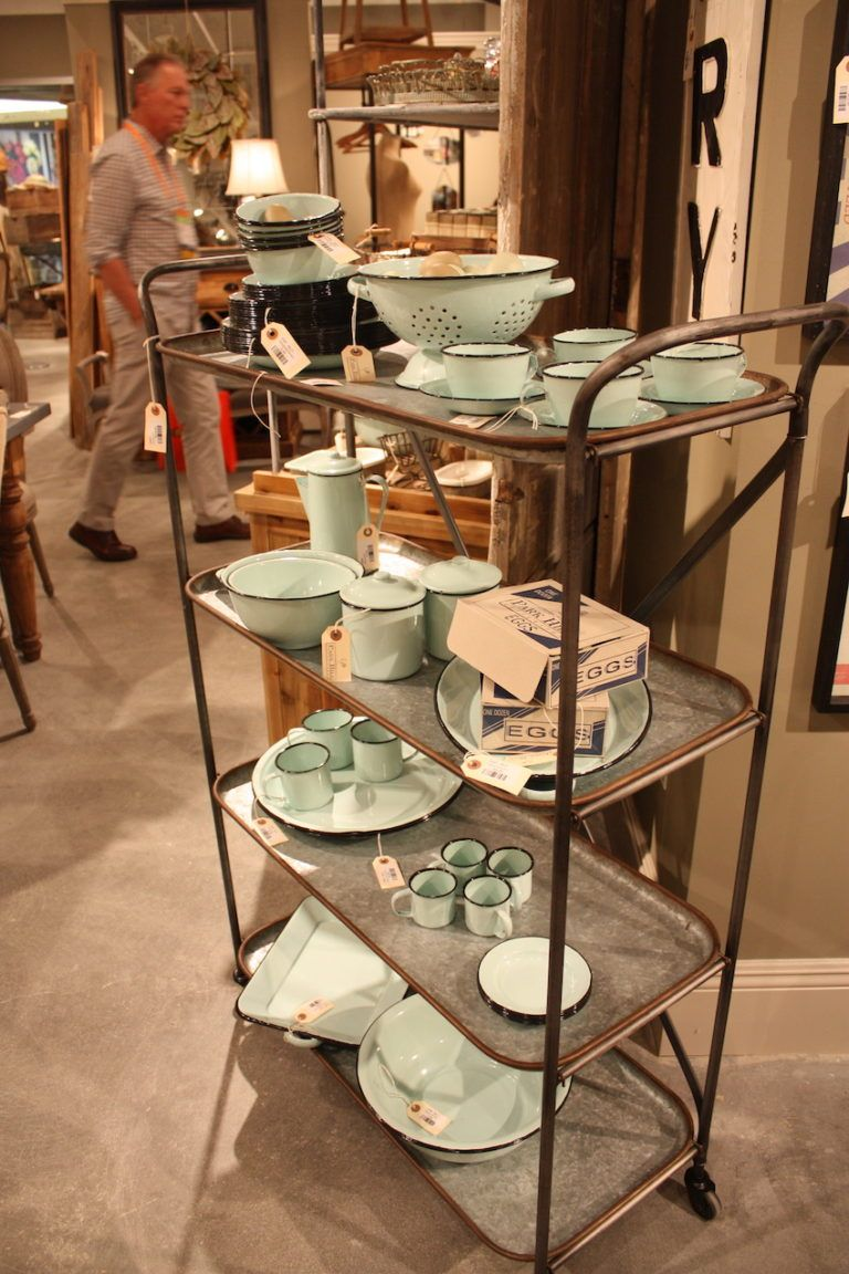 Park Hill's enamelware pieces sit atop a galvanized metal tea cart.
