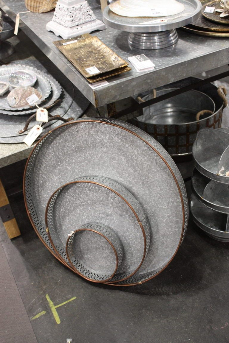Round galvanized trays have a copper edge that gives them a more refined rustic look.