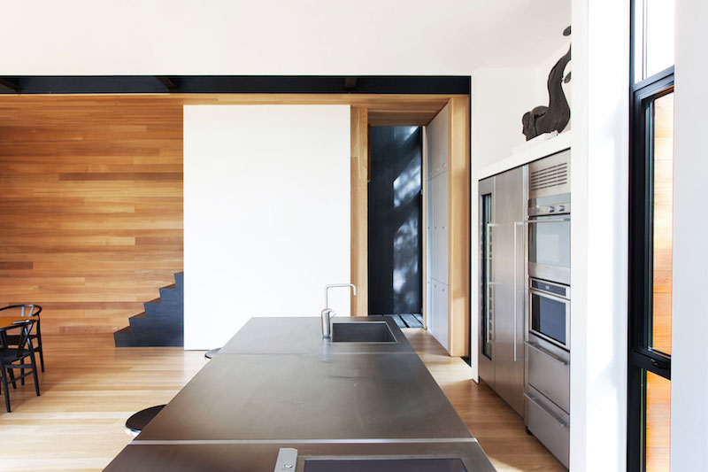 Sculptural tower house kitchen island