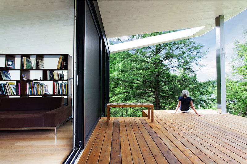 Sculptural tower house wooden deck