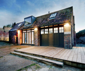 A Garage Extension Rebuilt Into A Rustic-Industrial Residence