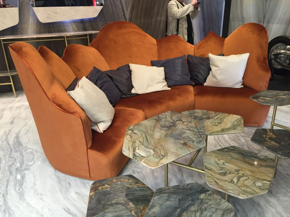 Velvet orange sofa with coffee tables and marble top