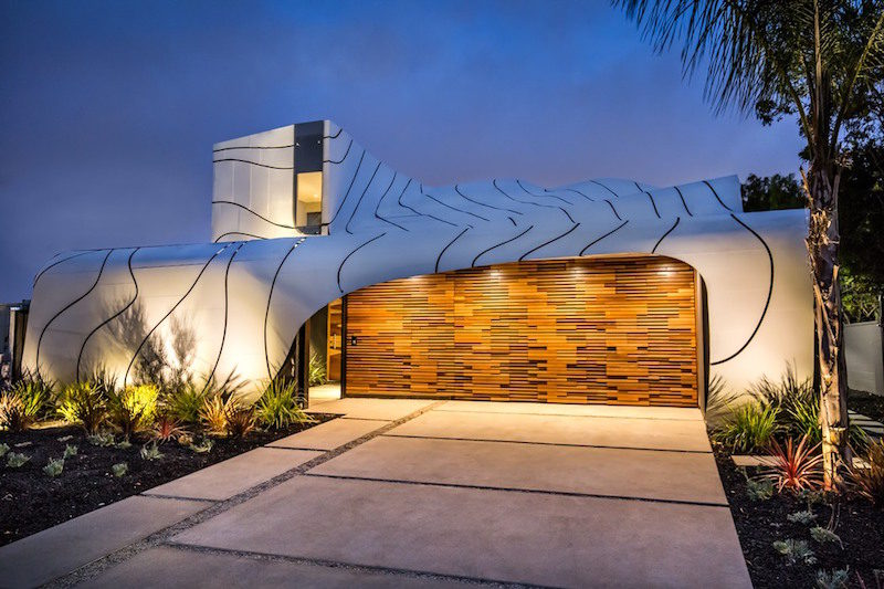 A House With An Artistic Design Inspired By Waves And Feathers