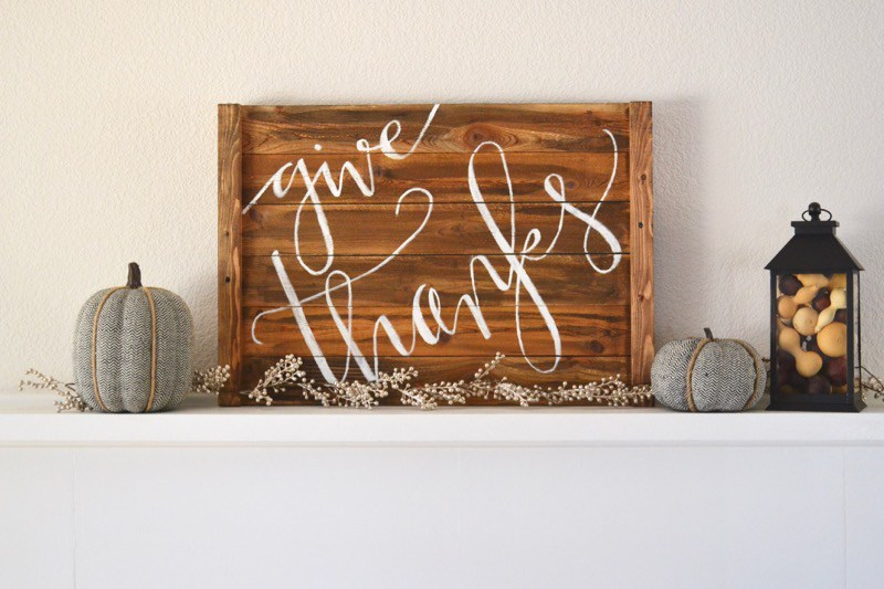 Wood holiday sign above fireplace