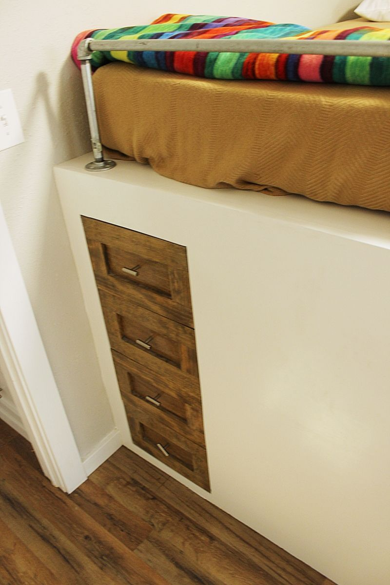 drawers on the foot of the upper bunk