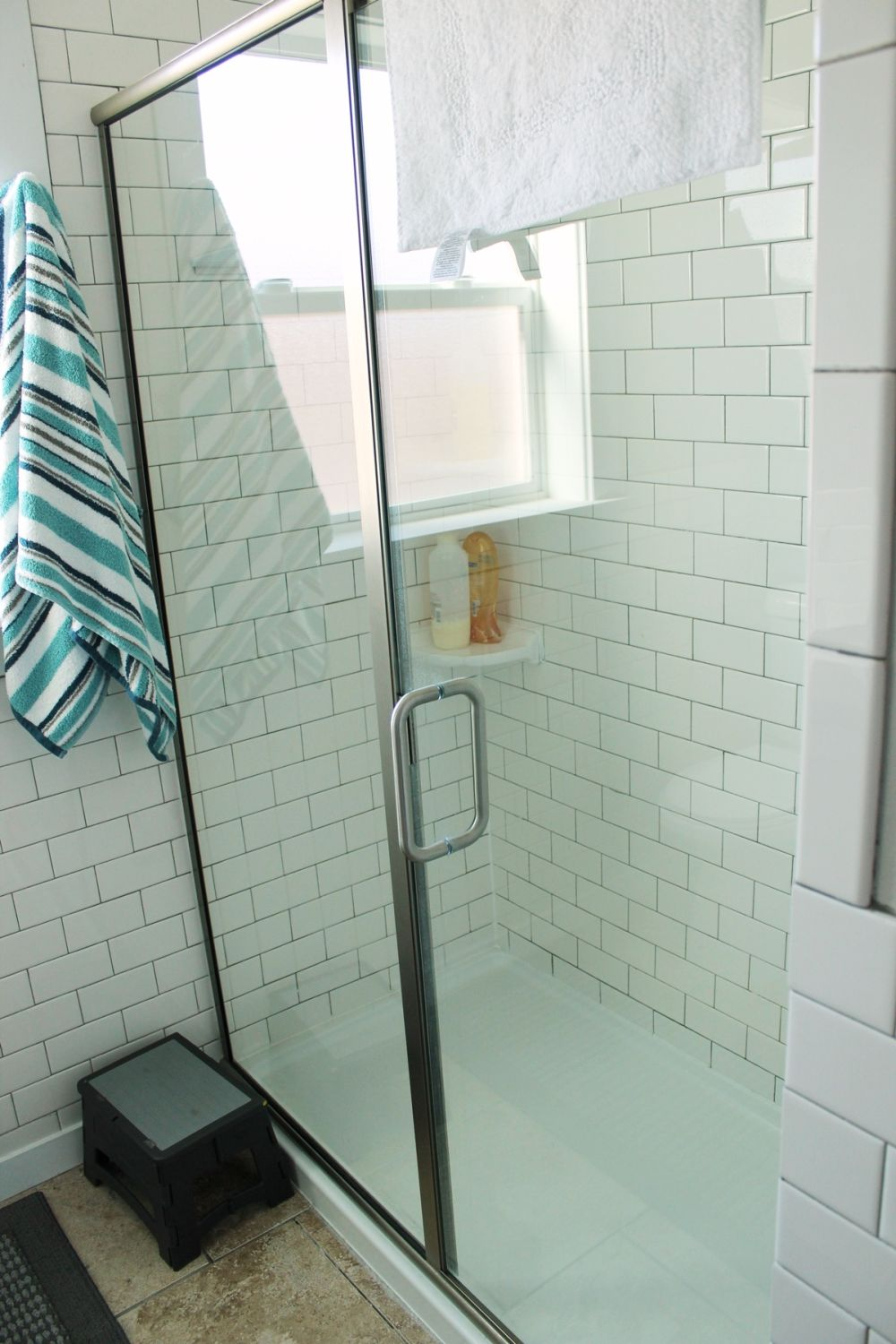 glass-doored walk-in shower