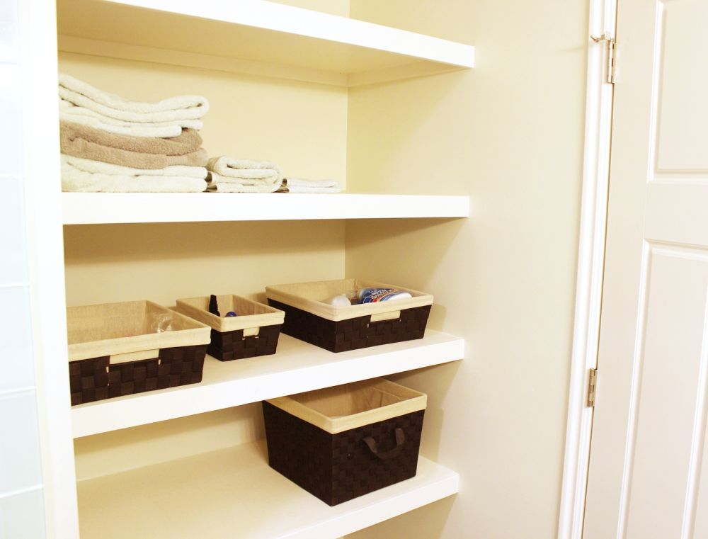 open shelves located behind the bathroom door